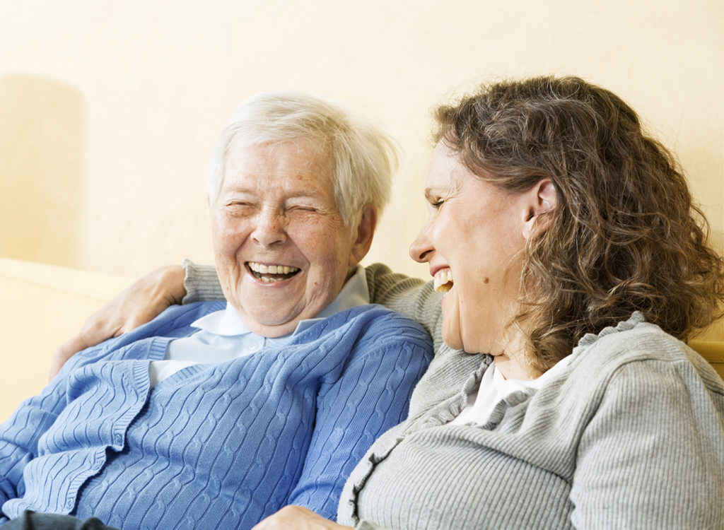 Client and caregiver laughing