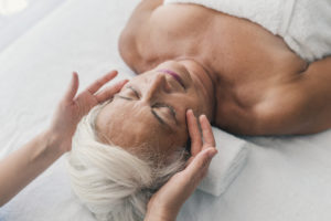 Elderly lady receiving a massage