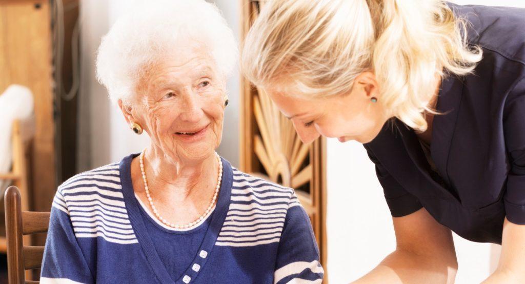 Caregiver Helping Lady