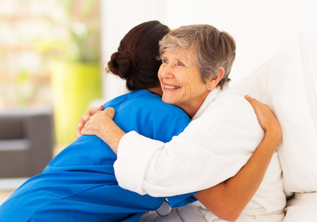 Woman hugging caregiver