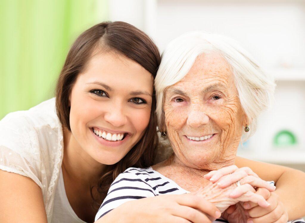 Caregiver hugging client